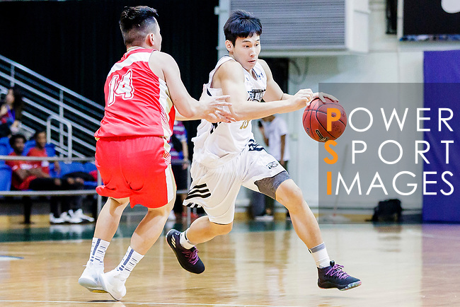 Fong Man Chung #18 of Eagle Basketball Team dribbles the ball up court against the Nam Ching during the Hong Kong Basketball League game between Eagle and Nam Ching at Southorn Stadium on June 22, 2018 in Hong Kong. Photo by Yu Chun Christopher Wong / Power Sport Images