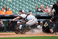 Sam Houston State Bearkats catcher Jordan Cannon (25) waits for the throw as Walker Grisanti (17) of the Vanderbilt Commodores slides across home plate to score a run in the top of the 10th inning in game one of the 2018 Shriners Hospitals for Children College Classic at Minute Maid Park on March 2, 2018 in Houston, Texas.  The Bearkats walked-off the Commodores 7-6 in 10 innings.   (Brian Westerholt/Four Seam Images)