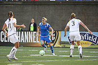 Kelly Smith (#10) of the Boston Breakers tries to start an attack as Brittany Bock (#11) and Allison Falk (#3) of the Los Angeles Sol defend.