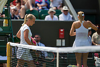 England, London, July 1, 2015, Tennis, Wimbledon, Richel Hogenkamp (NED) passes Maria Sharapova (RUS) at the changeover<br /> Photo: Tennisimages/Henk Koster