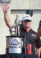 Nov. 13, 2011; Pomona, CA, USA; NHRA funny car driver Mike Neff with the championship trophy during the Auto Club Finals at Auto Club Raceway at Pomona. Mandatory Credit: Mark J. Rebilas-.