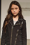 Model walks runway in an outfit by Hudson Kids, during the petitePARADE Children's Club fashion show at the Jacob Javits Center in New York City, on January 9, 2016.