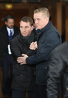 SWANSEA, WALES - MARCH 16: L-R Liverpool manager Brendan Rodgers greets Swansea manager Garry Monk prior to the Premier League match between Swansea City and Liverpool at the Liberty Stadium on March 16, 2015 in Swansea, Wales