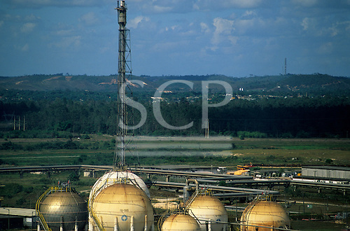Bahia State, Brazil. Petrobras petrochemical refinery at Camacari; gas storage vessels and flare tower.