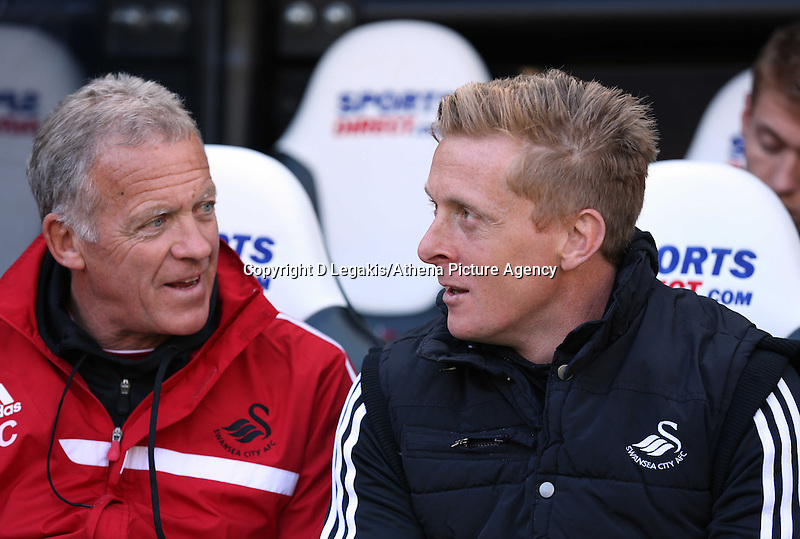 Pictured L-R: Swansea First team coach Alan Curtis and head coach Garry Monk. Saturday 19 April 2014<br /> Re: Barclay's Premier League, Newcastle United v Swansea City FC at St James Park, Newcastle, UK.