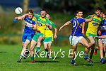 Gneeveguilla's DJ Murphy and Ronan Kerins of St Senans tussle for possession in the County Premier Junior football Quarter Final