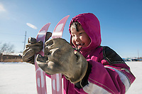 """Danny-Girl"" from Zackar Levi School in Lower Kalskag is overcome with joy after skiing for the first time with Skiku coaches. Skiku is a non-profit organization with the mission of creating a sustainable Nordic ski program in communities throughout Alaska. Volunteer coaches travel to villages each spring to instruct youngsters and distribute donated equipment with the goal of establishing ski programs at rural schools.  Photo by James R. Evans"