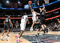 WASHINGTON, DC - JANUARY 28: Jagan Mosely #4 of Georgetown lobs a shot over Derrik Smits #21 of Butler during a game between Butler and Georgetown at Capital One Arena on January 28, 2020 in Washington, DC.