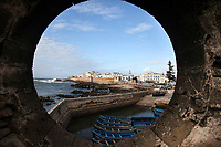 A view of Essaouira, Morocco from a porthole in one of the stone bastions surrounding the city.