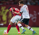 (L) Paulinho of Guangzhou Evergrande being followed by (R) Mario Gotze of Bayern Munich during the Bayern Munich vs Guangzhou Evergrande as part of the Bayern Munich Asian Tour 2015  at the Tianhe Sport Centre on 23 July 2015 in Guangzhou, China. Photo by Aitor Alcalde / Power Sport Images