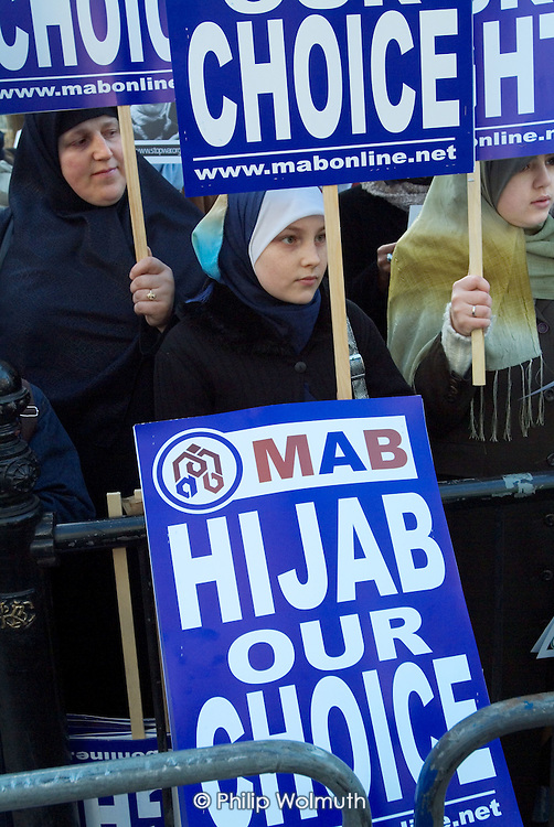 Protest outside the French Embassy in Knightsbridge, London, against the proposed ban on religious and political symbols in French state  schools, which would outlaw the wearing of the Muslim hijab.