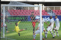 WASHINGTON, DC - NOVEMBER 8: Donovan Pines #23 of D.C. United scores against Clement Diop #23 of Montreal Impact during a game between Montreal Impact and D.C. United at Audi Field on November 8, 2020 in Washington, DC.