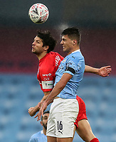 10th January 2021; Etihad Stadium, Manchester, Lancashire, England; English FA Cup Football, Manchester City versus Birmingham City; George Friend of Birmingham City competes for a header with Rodri of Manchester City