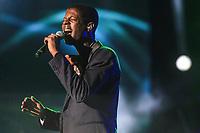 Karim Ouellet performs during the Hommage a Felix Leclerc concert at the Festival d'ete de Quebec on the plains of Abrahams in Quebec City Thursday July 3, 2014.