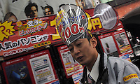 A salesman in an electronics shop, Tokyo, Japan. Japan has been hit extremely hard by the economic crisis as previously profitable electronic companies have all stumbled in recent months..