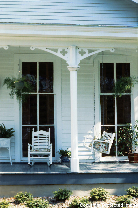 Oxford:  Hamblett-Brown House-detail.  Hanging plants, porch swing, rocking chair--common porch furniture.