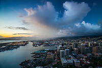 An aerial view at dusk of Honolulu Harbor and downtown Honolulu, O'ahu.
