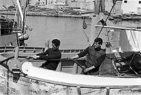 - North African immigrants on a fishing boat....- immigrati nordafricani su un peschereccio