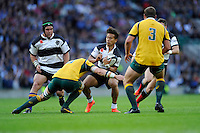 Tim Nanai-Williams of Barbarians is tackled by Ben McCalman of Australia during the Killik Cup match between Barbarians and Australia at Twickenham Stadium on Saturday 1st November 2014 (Photo by Rob Munro)