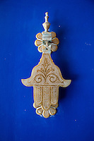 Essaouira, Morocco.  Doorknocker in the Form of the Hand of Fatima, to protect the household from evil.