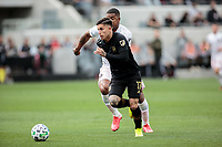 LOS ANGELES, CA - MARCH 01: Brian Rodríguez #17 of LAFC turns past  Roman Torres #29 of Inter Miami CF during a game between Inter Miami CF and Los Angeles FC at Banc of California Stadium on March 01, 2020 in Los Angeles, California.