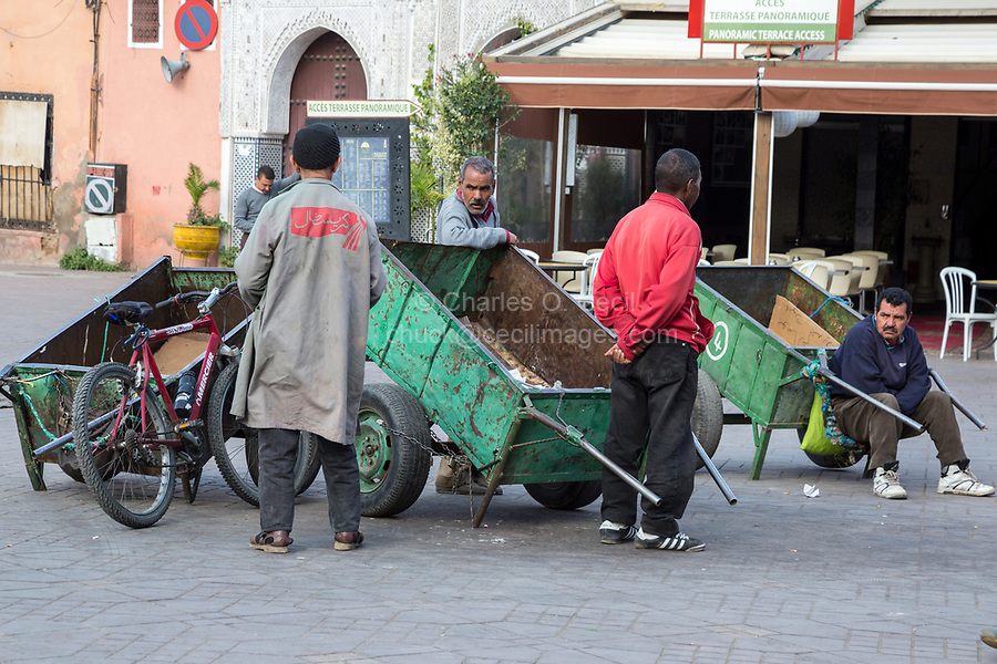 Marrakesh, Morocco.  Porters in the Place Jemaa El Fna Waiting for a Customer.