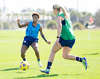 ORLANDO, FL - JANUARY 20: Crystal Dunn #19 of the USWNT is defended by Lindsey Horan #9 during a training session at the practice fields on January 20, 2021 in Orlando, Florida.