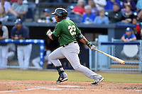 Savannah Sand Gnats first baseman Dominic Smith #22 swings at a pitch during a game against the Asheville Tourists at McCormick Field July 16, 2014 in Asheville, North Carolina. The Tourists defeated the Sand Gnats 6-3. (Tony Farlow/Four Seam Images)