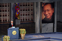 The Norwegian Nobel Committee decided to award.the Nobel Peace Prize for 2010 to Liu Xiaobo. Leader of the Norwegian Nobel Committee Thorbjørn Jagland elaborated on their decision to award the prize to Xiaobo during the ceremony in Oslo Town Hall. .Liu Xiaobo is imprisoned and no immediate family was permitted to leave China to accept the prize. ..Photo: Fredrik Naumann/Felix Features