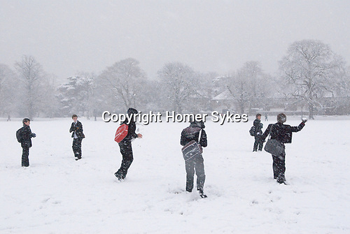 Winter snowball fight Wimbledon Common London Uk . Kids playing in the snow January 2010