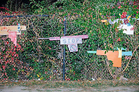 A fence is decorated with cardboard and wooden guns as a message to stop gun violence in Boston, Massachusetts, on Fri., Sept. 25, 2020.