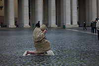 Argentinian Cardinal Jorge Mario Bergoglio was elected as the 266th Pontiff and will lead the world's 1.2 billion CatholicsFaithful shelter from rain while waiting for smoke to rise from a chimney on top of the Sistine Chapel during the second day of voting for the election of a new pope, at the Vatican March 13, 2013. Roman Catholic Cardinals will continue their conclave meeting inside the Vatican's Sistine Chapel