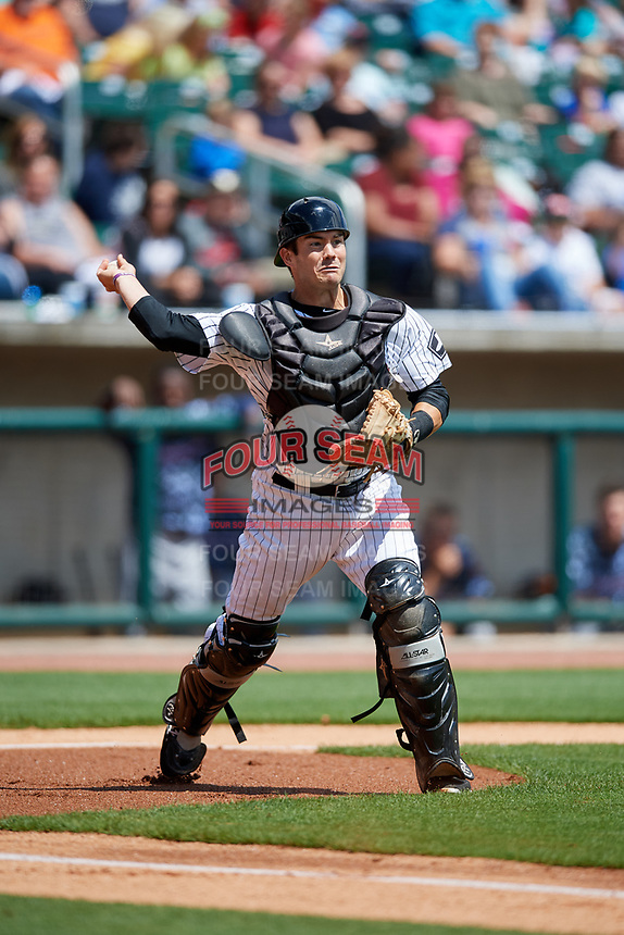 Birmingham Barons catcher Brett Austin (18) throws to first base during a game against the Jacksonville Jumbo Shrimp on April 24, 2017 at Regions Field in Birmingham, Alabama.  Jacksonville defeated Birmingham 4-1.  (Mike Janes/Four Seam Images)