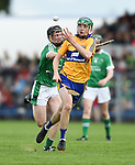 Billy Connors of Clare in action against Brian Mc Partland of Limerick during their Munster U-21 hurling quarter final at Cusack park. Photograph by John Kelly.