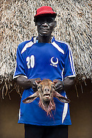A goat is slaughtered to celebrate the homecoming of Joseph Gatyoung Khan. Joseph is a Lost Boy. He was among the thousands who fled Sudan during the civil war, and after living in the United States, he is returning for the first time in 22 years. Many Sudanese are returning home, mainly to participate in the upcoming referendum in January 2011 when South Sudan will vote on its independence..