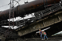 Civilians escape through the railroad  bridge blown up by Donetsk People Republic partisans. Novobahmutivka. 20 km on the road from Donetsk to Slovyansk. July 07, 2014