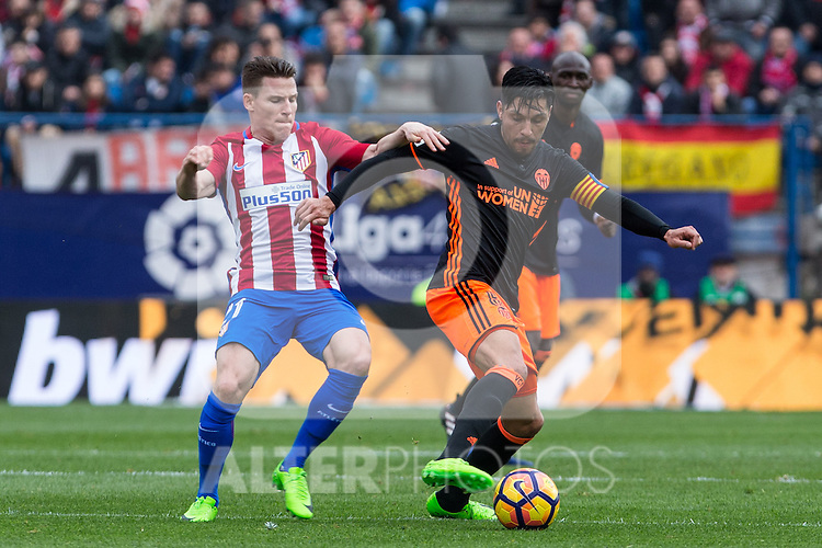 Kevin Gameiro of Atletico de Madrid competes for the ball with Enzo Perez of Valencia CF  during the match of Spanish La Liga between Atletico de Madrid and Valencia CF at  Vicente Calderon Stadium in Madrid, Spain. March 05, 2017. (ALTERPHOTOS / Rodrigo Jimenez)