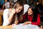 Education high school female teacher working with female student in mathematics class