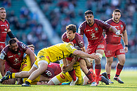 22nd May 2021; Twickenham, London, England; European Rugby Champions Cup Final, La Rochelle versus Toulouse; Antoine Dupont of Toulouse is tackled