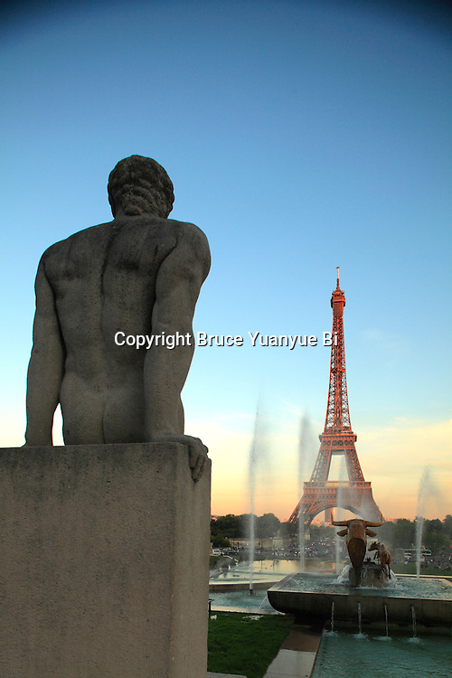 Statue and fountains in Jardins Trocadero with Eiffel Tower in the background.City of Paris. Paris. France