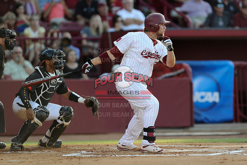 First baseman Kyle Martin (33) of the South Carolina Gamecocks bats in an NCAA Division I Baseball Regional Tournament game against the Maryland Terrapins on Sunday, June 1, 2014, at Carolina Stadium in Columbia, South Carolina. The Maryland catcher is Kevin Martir. Maryland won, 10-1, to win the tournament. (Tom Priddy/Four Seam Images)
