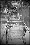 Due to the high level of pollutants in the Atoyac River in Oaxaca, Mexico, a local man, Mr. Rodriguez, built his own foot bridge to allow people easier access to the main market without having to wade through the water which has caused illness. He charges about 20 cents to cross and subsidizes his retirement income...