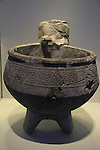 Israel, Jerusalem, statue of a figure with a basin from Tel Hazor, 1500-1300 BC, on display at the Israel Museum