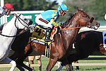 August 2, 2015. First time past the stands in the Haskell Invitational, American Pharoah, Victor Espinoza up, is in second place behind Competitive Edge and followed by Mr. Jordan (Paco Lopez up).American Pharoah  wins the  Grade I William Hill Haskell Invitational Stakes, one and 1/8 miles on the dirt  for three year olds at Monmouth Park in Oceanport, NJ. Bob Baffert is trainer; Ahmed Zayat is owner. Joan Fairman Kanes/ESW/CSM