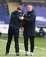 1st May 2021; Liberty Stadium, Swansea, Glamorgan, Wales; English Football League Championship Football, Swansea City versus Derby County; Wayne Rooney, Manager of Derby County congratulates Steve Cooper, Manager of Swansea City after the final whistle