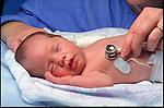 doctor examining newborn infant in hospital