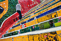 A man climbs the Selaron's Stairs (Escadaria Selarón), a mosaic staircase made of colorful tiles, in Rio de Janeiro, Brazil, 12 February 2012. World-famous staircase, mostly covered by vibrant yellow, green and blue tiles (inspired by the colors of the Brazilian flag), is the masterpiece of Chilean-born artist Jorge Selarón who considers it as a personal tribute to the Brazilian people. Connecting the neighborhoods of Santa Teresa and Lapa, the stairway is made up of 250 steps and measures 125 meters long. In 1990 Selarón began work on the stairway, creating a constantly evolving piece of art, now adorned with over 2,000 brightly colored tiles collected from over 60 countries. Selarón funds his one man's project through donations and the sale of his black-and-red paintings which mostly depict a pregnant African woman or himself. Living his passion, the eccentric 65-year-old artist claims that this crazy and unique dream will only end on the day of my death.