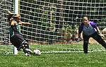 Soccer player cuts hard and kicks a goal.