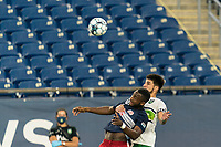 FOXBOROUGH, MA - AUGUST 26: Mayele Malango #10 of New England Revolution II and Cesar Murillo #4 of Greenville Triumph SC battle for head ball during a game between Greenville Triumph SC and New England Revolution II at Gillette Stadium on August 26, 2020 in Foxborough, Massachusetts.