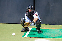 Wisconsin Timber Rattlers catcher KJ Harrison (24) warms up in the bullpen prior to a Midwest League game against the Lansing Lugnuts on May 8, 2018 at Fox Cities Stadium in Appleton, Wisconsin. Lansing defeated Wisconsin 11-4. (Brad Krause/Four Seam Images)